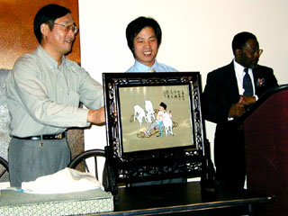 Presentation of embroidered gift.